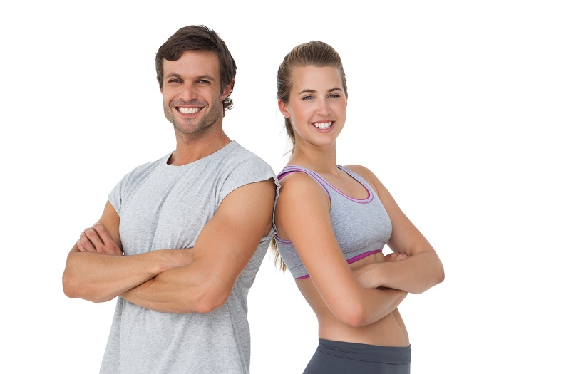 Portrait of a sporty young couple with arms crossed