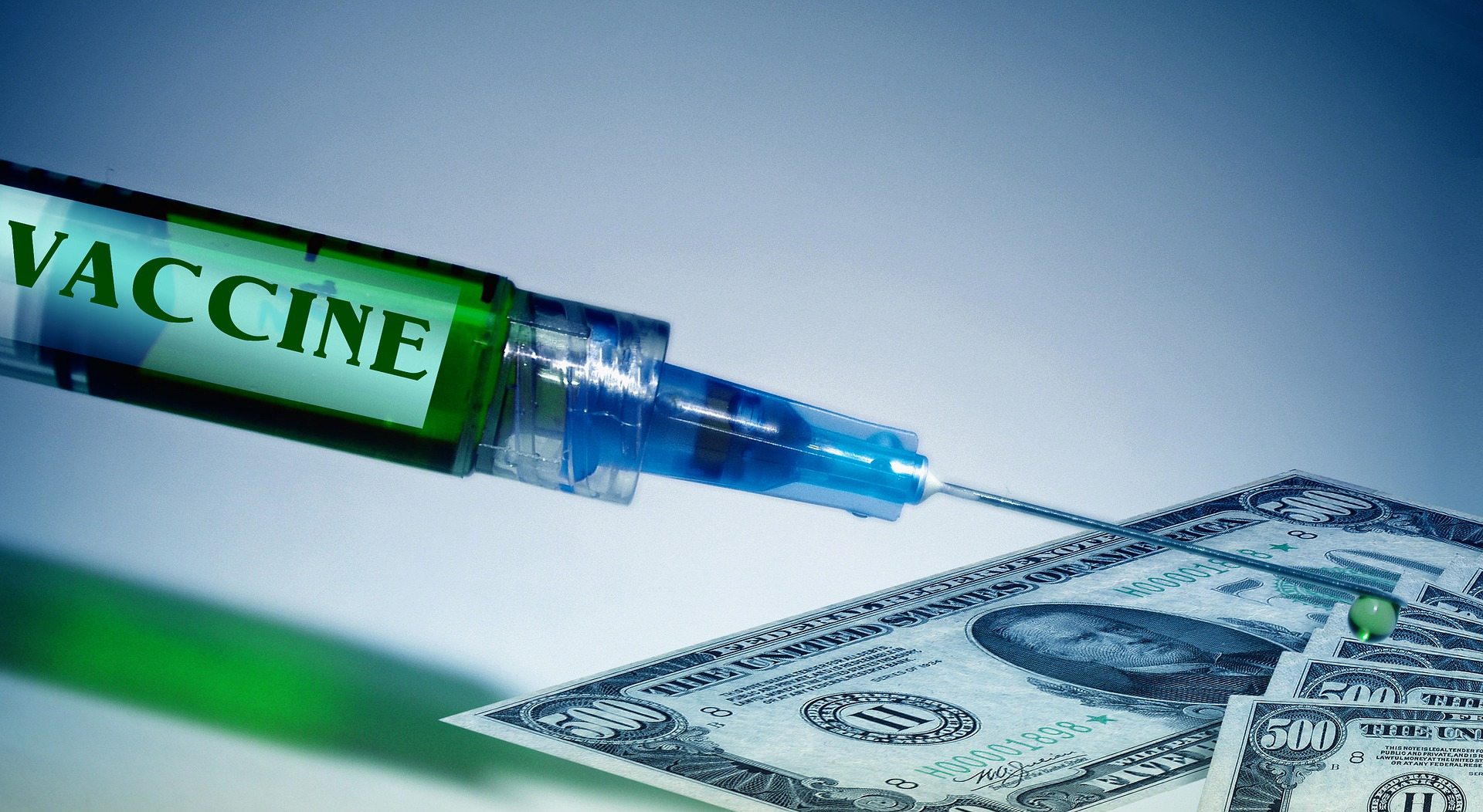 syringe vaccine dollar bills