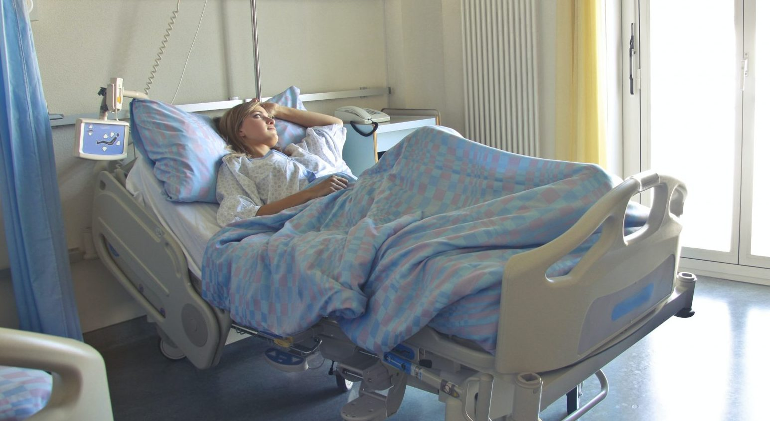 woman patient hospital bed